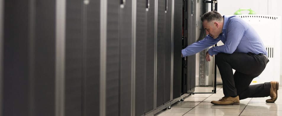 Man does maintenance on data center hardware